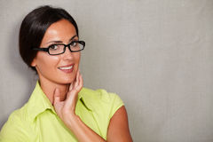 Toothy smiling lady with glasses and hand on face Royalty Free Stock Image