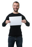 Toothy smiling man showing a blank paper sheet. Isolated on white background Royalty Free Stock Photo
