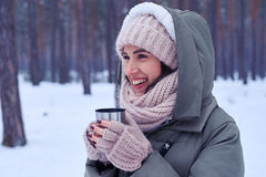 Toothy smiling model with a cup of coffee looking sideways Stock Photos