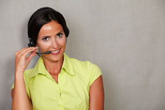 Toothy smiling receptionist talking on headset Stock Photo