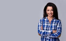 Toothy smiling woman in casual blue shirt. Isolated Royalty Free Stock Image