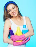 Toothy smiling woman hold three bottle chemistry for cleaning h. Ouse. Housewife ready for work Royalty Free Stock Images