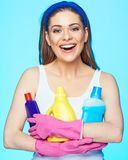 Toothy smiling woman hold three bottle chemistry for cleaning h. Ouse. Housewife ready for work Stock Images
