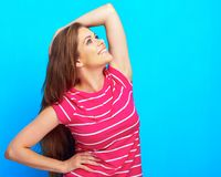 Toothy smiling woman in pink clothes standing over blue backgro. Und. Isolated Royalty Free Stock Photo