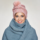 Toothy smiling woman portrait wearing winter scarf and hat. Studio isolated Stock Photography