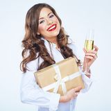 Toothy smiling woman with red lips holding gift box and vine gl. Ass. Curly hair Stock Image