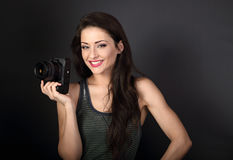 Toothy smiling young female professional photograph holding came Royalty Free Stock Photo