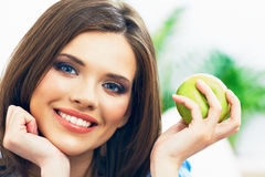 Toothy smiling young woman close up face portrait. With green apple Royalty Free Stock Photos