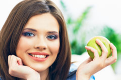 Toothy smiling young woman close up face portrait. With green apple Royalty Free Stock Photo