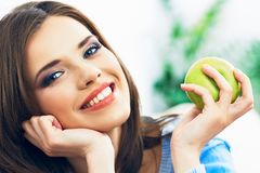 Toothy smiling young woman close up face portrait. With green apple Royalty Free Stock Photography