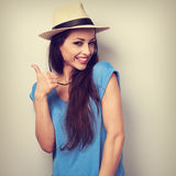 Toothy smiling young woman in summer hat showing thumb up sign. Stock Photography