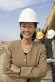 Topógrafo And Construction Workers en sitio Foto de archivo