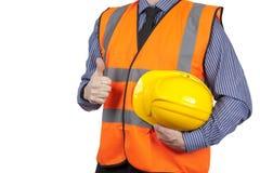 Topógrafo da construção na veste alaranjada da visibilidade que dá os polegares acima Fotografia de Stock