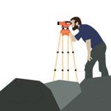 Topógrafo de sexo masculino en una roca Imagen de archivo