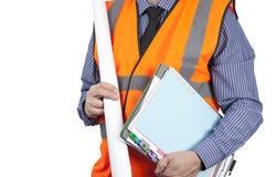 Topógrafo del edificio en carpetas que llevan del chaleco anaranjado de la visibilidad y Fotografía de archivo