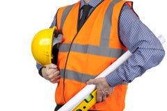 Topógrafo del edificio en dibujos que llevan del chaleco anaranjado de la visibilidad Fotografía de archivo