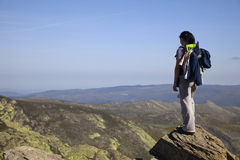 On the top. A trekker on top of the Mountain Royalty Free Stock Photography