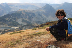 On the top. Landscape in a high mountain Rila with a little boy on the top Stock Image