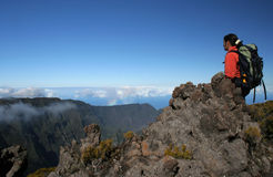 On the top. A trekker on top of the Mountain, above clouds (Reunion Island/Africa Stock Photography