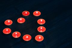Top above averhead close up photo of beautiful cute nice charming wonderfuk candles in shape of heart. Candles in shape of red hea Stock Image