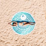 Aerial Drone View Of Woman In Swimsuit Bikini Relaxing And Sunbathing On Round Turquoise Beach Towel Near The Ocean. Top Aerial Drone View Of Woman In Swimsuit royalty free stock images