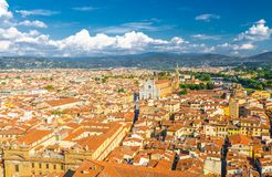 Top aerial panoramic view of Florence city historical centre, Basilica di Santa Croce di Firenze. Buildings houses with orange red tiled roofs, hills range stock photography