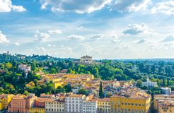 Top aerial panoramic view of Forte di Belvedere and green hills of Arcetri village, row of buildings, Florence, Italy royalty free stock photography