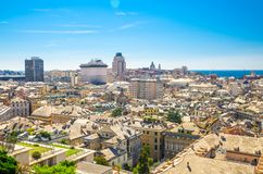 Top aerial scenic panoramic view of european city Genoa. Top aerial scenic panoramic view from above of old historical centre quarter and modern districts of royalty free stock image
