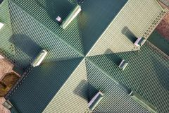 Top aerial view of building green shingle tiled roof construction. Abstract background, geometrical pattern.  royalty free stock images