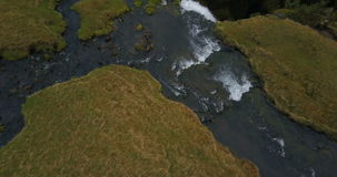 Top aerial view of flow of river in valley and fall down from the mountain. Beautiful Gljufrabui waterfall in Iceland. stock video footage