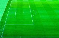 Top aerial view of football pitch soccer field with green grass lawn stock photos