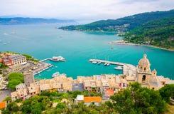 Top aerial view of Gulf of Spezia turquoise water, dome of Chiesa di San Lorenzo church, port marine of Portovenere. Town, Palmaria island, Ligurian sea royalty free stock image