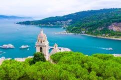 Top aerial view of Gulf of Spezia turquoise water, dome of Chiesa di San Lorenzo church in Portovenere. Town, Palmaria island, blue sky, Ligurian sea, Riviera royalty free stock image