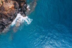 Free Top Aerial View Of Turquoise Atlantic Ocean Water Waves Crashing On Rocks On The Portuguese Madera Island Seashore Royalty Free Stock Photos - 185255658