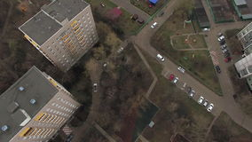 Top aerial view of one of Moscow yard, cloudy weather. Urban cityscape from quadrocopter stock video