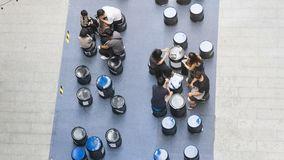 Top aerial view of people sit and talk picnic in pedestrian street. The top aerial view of people sit and talk picnic in pedestrian street Royalty Free Stock Photo