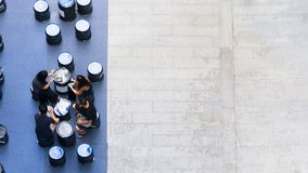 Top aerial view of people sit and talk picnic in pedestrian street. The top aerial view of people sit and talk picnic in pedestrian street Stock Photo