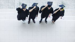Top aerial view of people students in the feeling of happy and. The Top aerial view of people students in the feeling of happy and graceful with the graduation royalty free stock photos