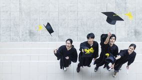 Top aerial view of people students in the feeling of happy. And graceful with the graduation gowns throw up the cap royalty free stock image