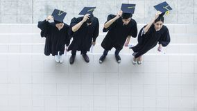 Top aerial view of people students in the feeling of happy. And graceful with the graduation gowns throw up the cap royalty free stock photography