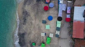 Top Aerial view on recreation area with umbrellas on beach in Bali. Indonesia Stock Photography