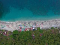 Top Aerial view on recreation area with umbrellas on beach in Bali. Indonesia Stock Photo