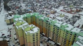 Top aerial view of tall residential apartment building stock video