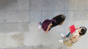 Top aerial view teen girls talk and meet at pedestrian walk way. The top aerial view teen girls talk and meet at pedestrian walk way Stock Photography