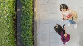 Top aerial view teen girls talk and meet at pedestrian walk way. The top aerial view teen girls talk and meet at pedestrian walk way Royalty Free Stock Images