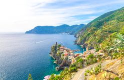 Op aerial view of Vernazza typical village with colorful buildings houses, Castello Doria castle on rock cliff and Genoa Gulf, Lig royalty free stock photography