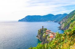 Top aerial view of Vernazza typical village with colorful buildings houses, Castello Doria castle on rock cliff and Genoa Gulf, Li royalty free stock photo