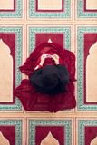 Top aerial view Young beautiful Muslim Woman Praying In Mosque.  Stock Photos