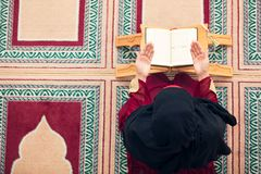 Top aerial view Young beautiful Muslim Woman Praying In Mosque.  Stock Image