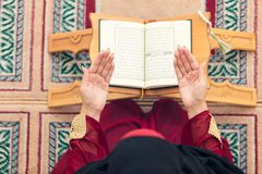 Top aerial view Young beautiful Muslim Woman Praying In Mosque.  Royalty Free Stock Photo